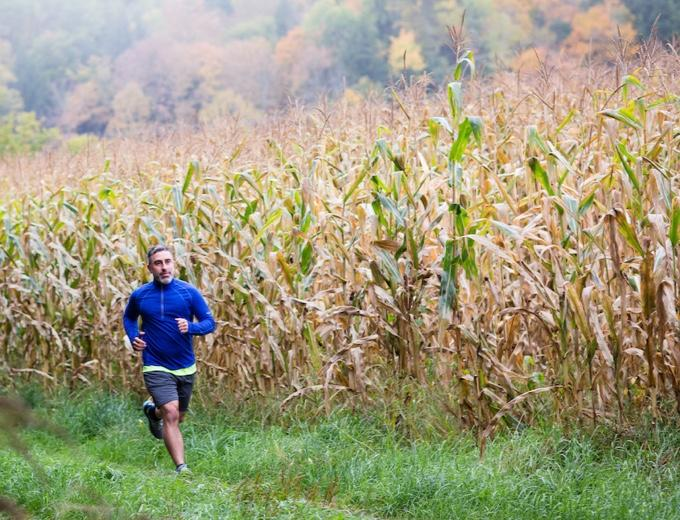 Mike running through a cornfield